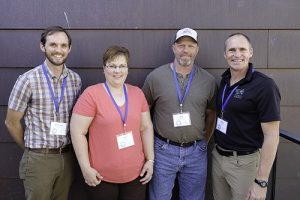 Stewardship Associate Andrew Moe, Lori & Jon Peterson, and Executive Director Kris Larson