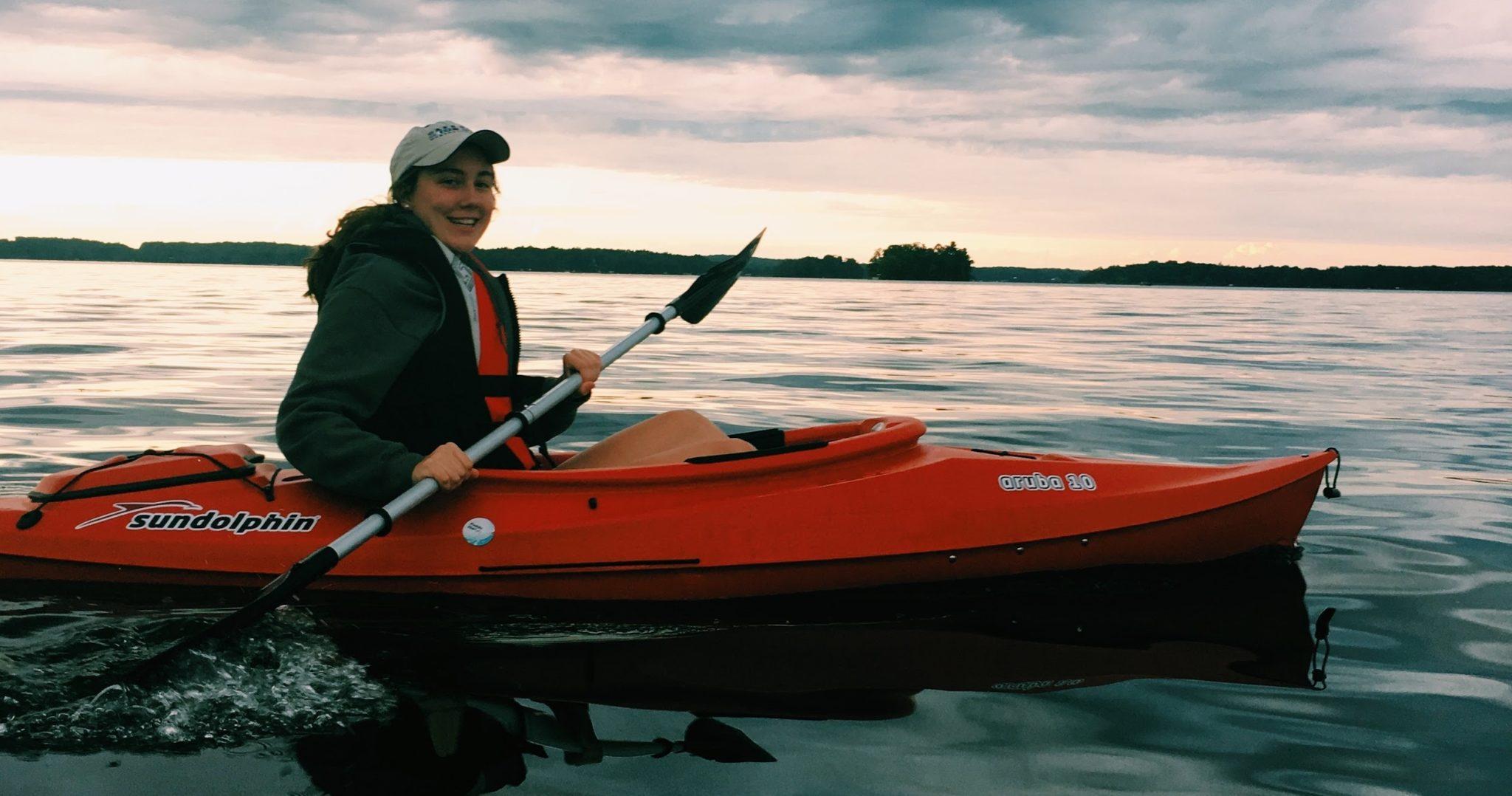 Katherine paddling on lake