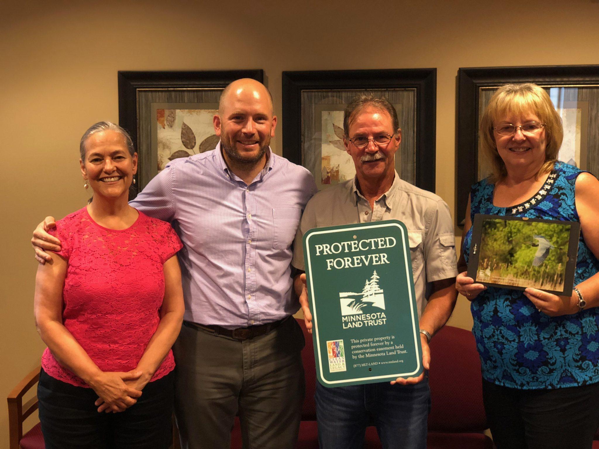 Gena Setzer and Nick Bancks (Minnesota Land Trust), Bill and Dawn Farrell