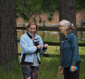 Artist talking with Land Trust staff