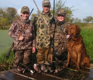 hunting group with dog