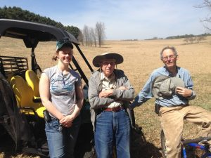 John (center) with his son David and Minnesota Land Trust Kristina Geiger on their protected property.